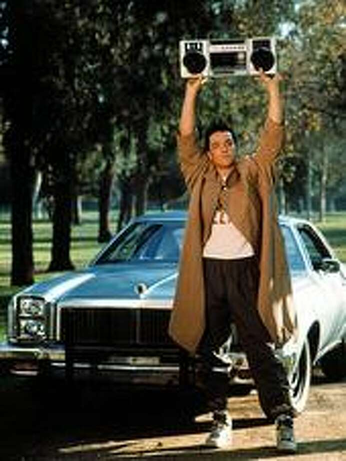 "John Cusack, as ""Lloyd Dobler,"" in the movie ""Say Anything"" in 1989.  Famous Lloyd quote: ""I don't want to sell anything, buy anything, or process anything as a career. I don't want to sell anything bought or processed, or buy anything sold or processed, or process anything sold, bought, or processed, or repair anything sold, bought, or processed."""