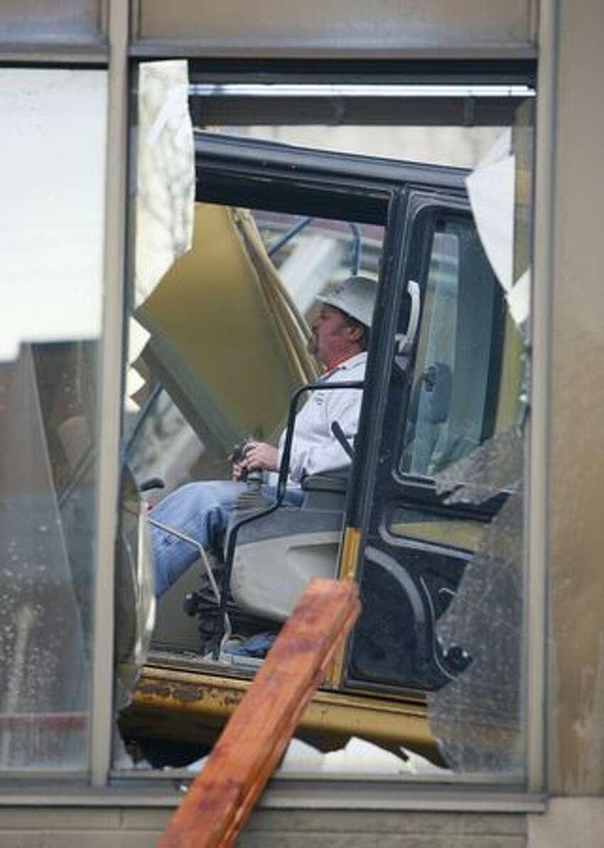A crew begins demolition of Sunset Bowl.