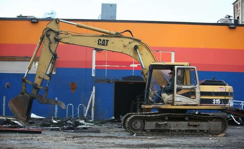 A crew begins demolition work on the Sunset Bowl building in Ballard.