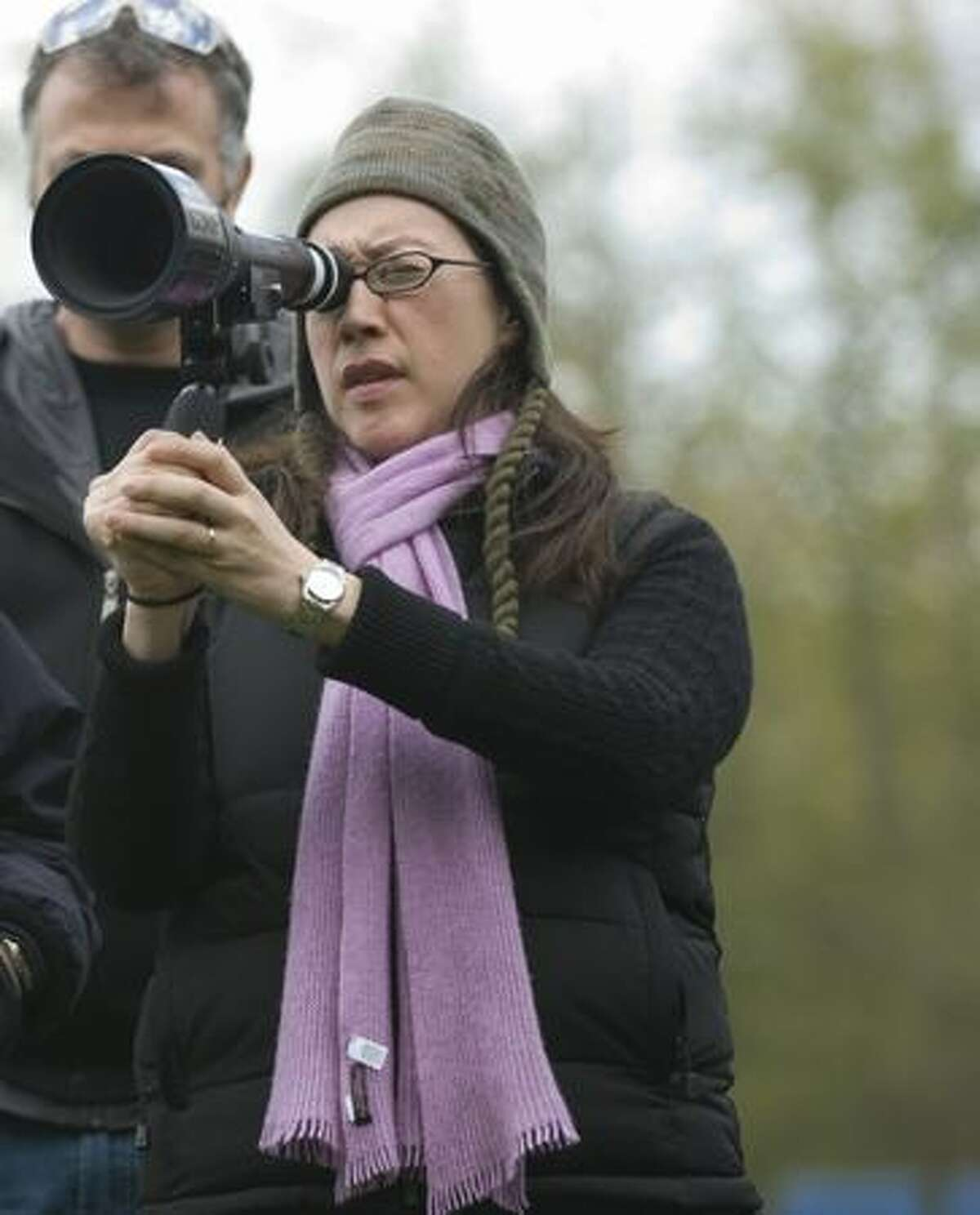Director Karyn Kusama lines up a shot on the set of