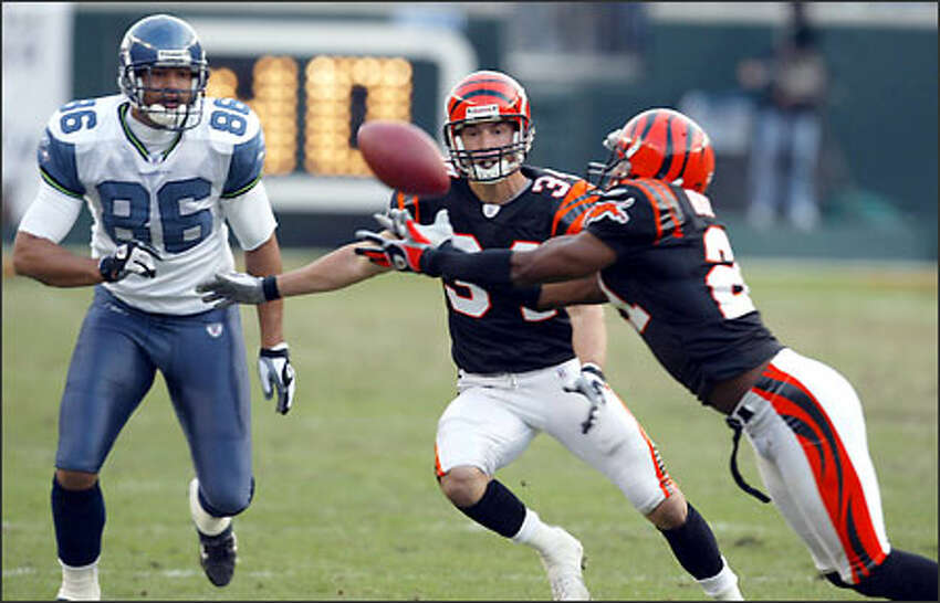 Seahawks tight end Jerramy Stevens (86) and Bengals free safety Kevin Kaesviharn (34) watch as Bengals cornerback Jeff Burris (21) intercepts with 1:46 left in the fourth quarter of play.