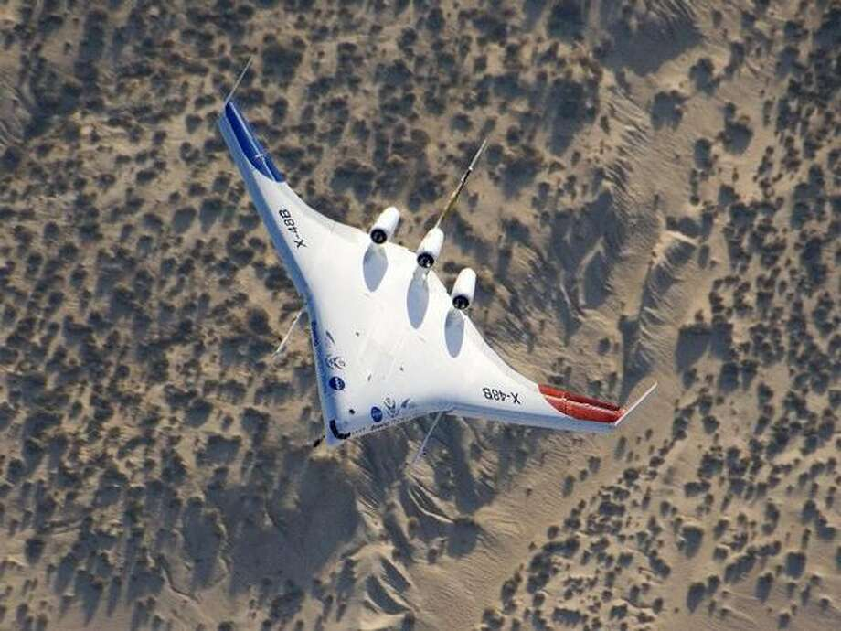 The unique X-48B Blended Wing Body subscale demonstrator banks over desert scrub at Edwards Air Force Base during the aircraft's fifth test flight Aug. 14, 2007. (NASA/Carla Thomas)