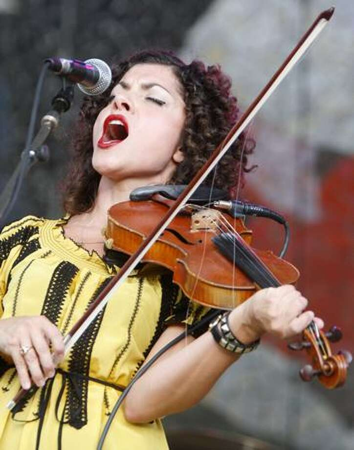 Carrie Rodriguez of Austin, Texas, performs her brand of fiddle blues, country and rock & roll at the Starbucks Stage at the Mural Amphitheatre during Bumbershoot 2009 on Saturday at the Seattle Center. Photo: Joshua Trujillo, Seattlepi.com
