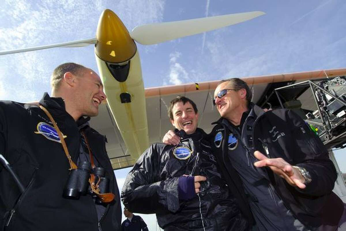 (From left) Swiss scientist-adventurer and pilot Bertrand Piccard, test pilot Markus Scherdel and Solar Impulse Chief Executive Andre Borschberg celebrate after the first test flight of Solar Impulse aircraft on April 7, 2010 from Payerne's air base, western Switzerland.