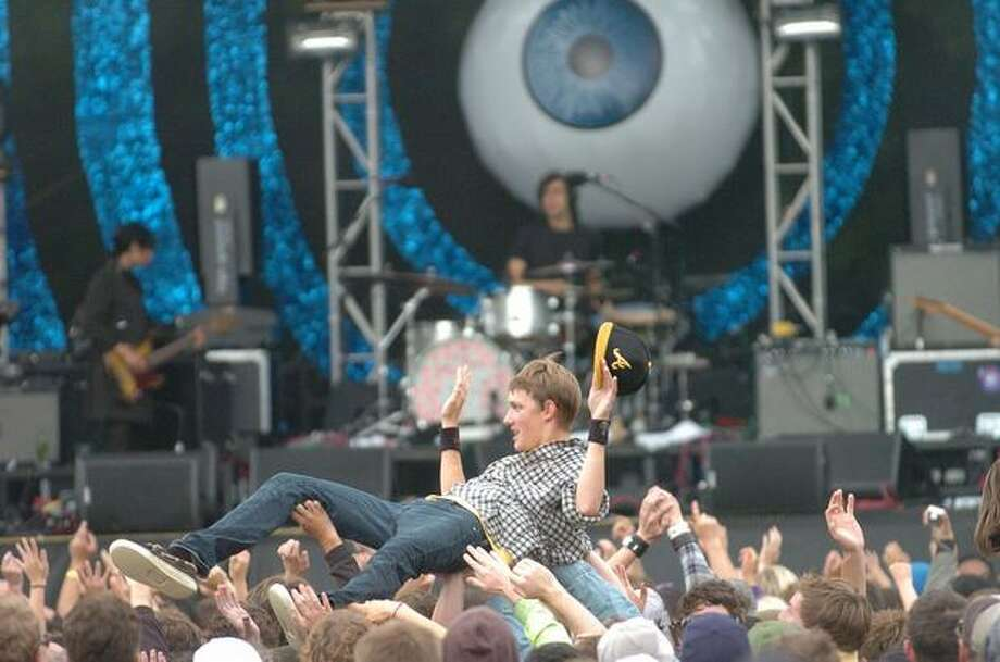 A crowd member surfs during the Yeah Yeah Yeahs performance. Photo: Daniel Berman, Seattlepi.com