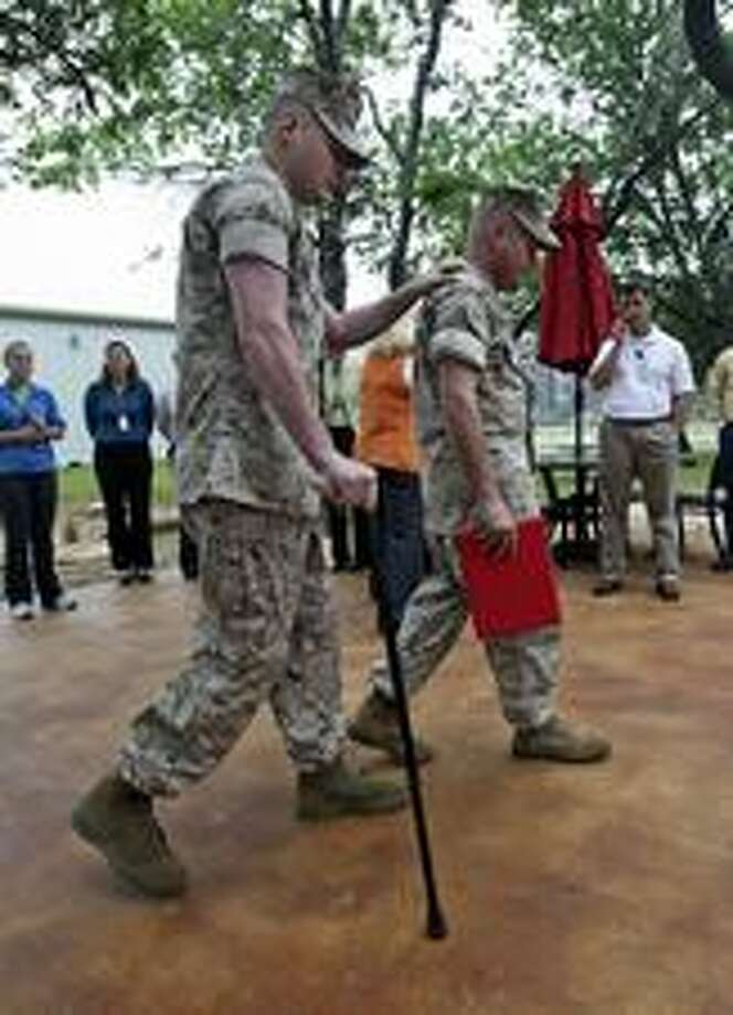 Bradford leans on another Marine. Photo: Tom Reel, San Antonio Express-News