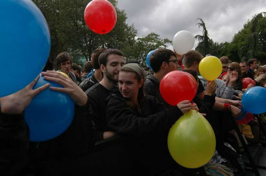 Crowd members play with balloons passed out by the U.S.E. band before their show on the Broad Street Stage. Photo: Daniel Berman, Seattlepi.com
