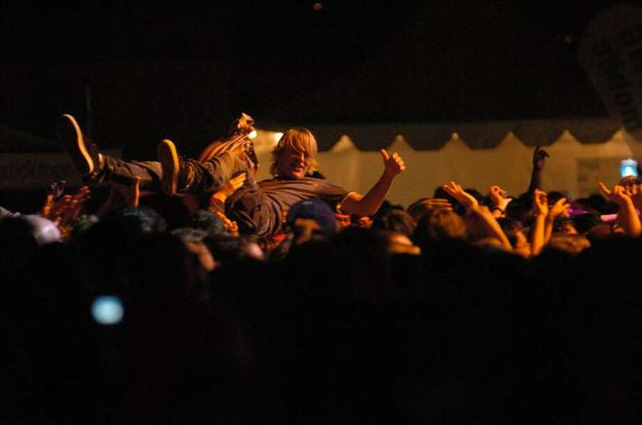 A crowd member surfs at the start of a concert by Jason Mraz and his band. Photo: Daniel Berman, Seattlepi.com