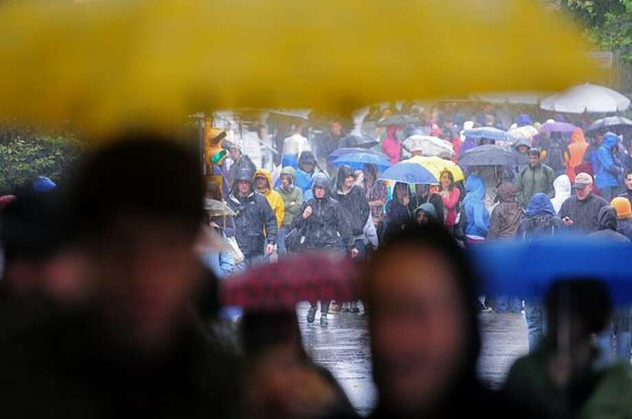 Crowds brave their way through the rain on the final day of Bumbershoot Monday in Seattle. Photo: Daniel Berman, Seattlepi.com