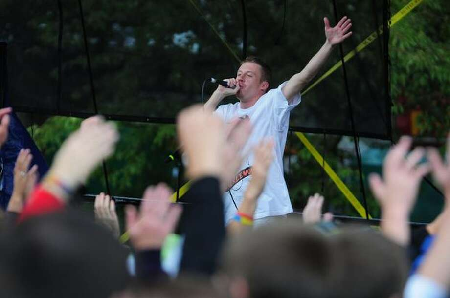 Macklemore performs on the Fisher Green stage on the final day of Bumbershoot in Seattle. Photo: Daniel Berman, Seattlepi.com