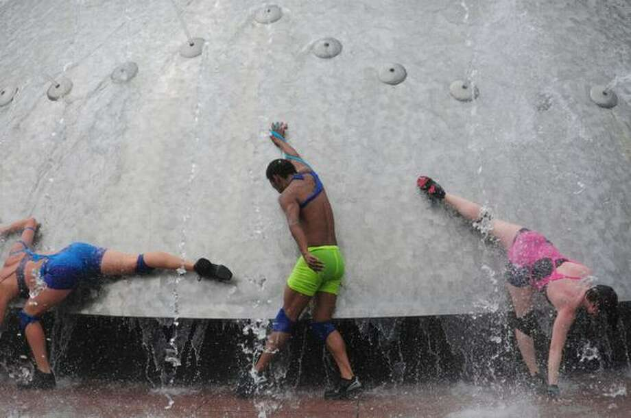 A performance art group dances in the International Fountain on the final day of Bumbershoot. Photo: Daniel Berman, Seattlepi.com