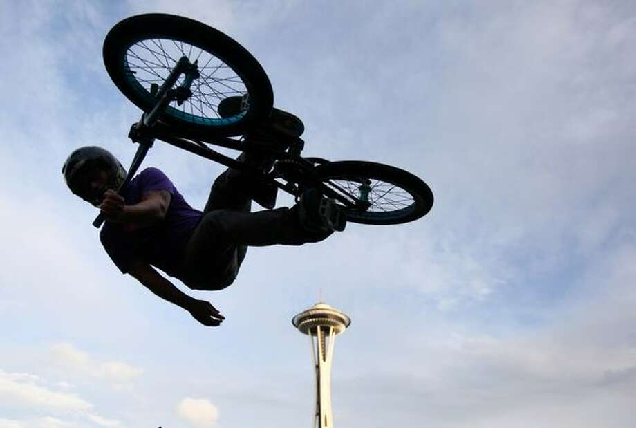 A member of the Rockstar Energy Drink demo team performs on a half-pipe. Photo: Joshua Trujillo, Seattlepi.com