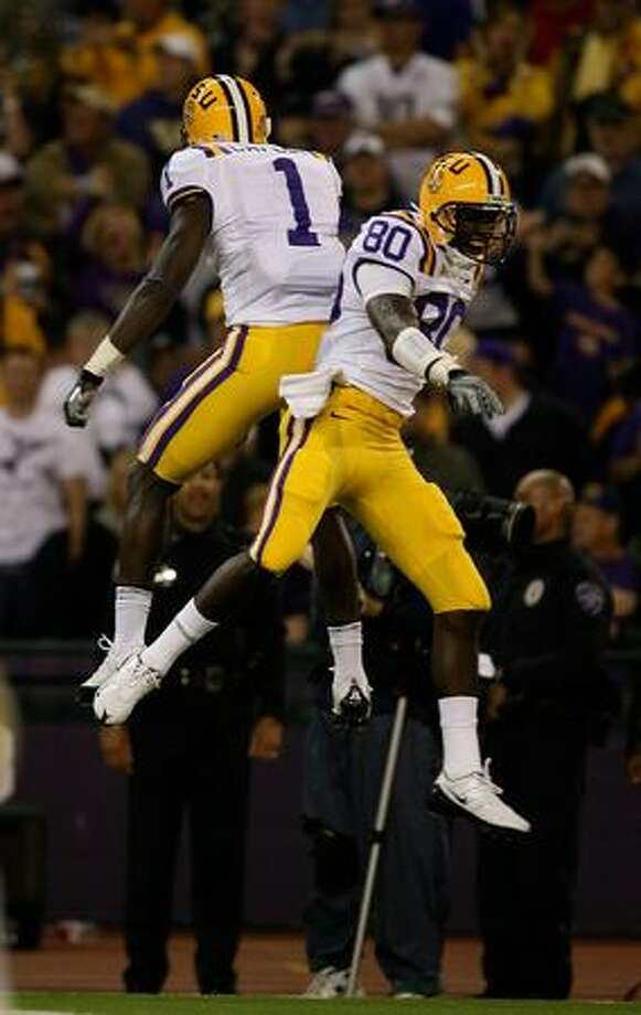 SEATTLE - SEPTEMBER 05: Wide receiver Terrance Toliver #80 of the LSU Tigers celebrates with Brandon LaFell #1 after scoring on a 49 yard touchdown against the Washington Huskies on September 5, 2009 at Husky Stadium in Seattle, Washington. Photo: Getty Images