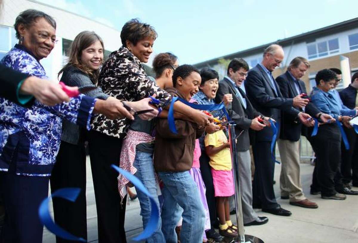 Community members, including Seattle Public Schools Superintendent Maria Goodloe-Johnson, third from left, cut a ceremonial ribbon in front of the new South Shore School.