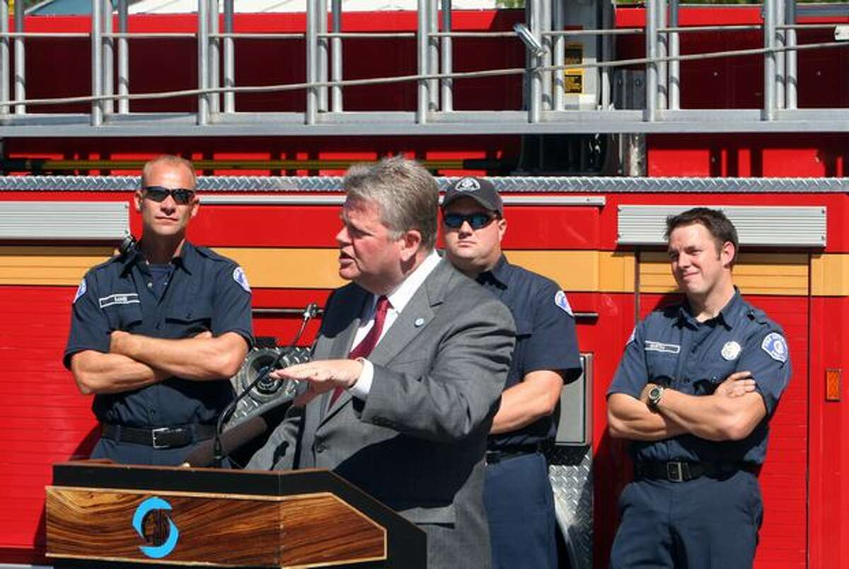 Mayor Greg Nickels, standing in from of firefighters from station 38, at a Sept. 10, 2009 groundbreaking ceremony.