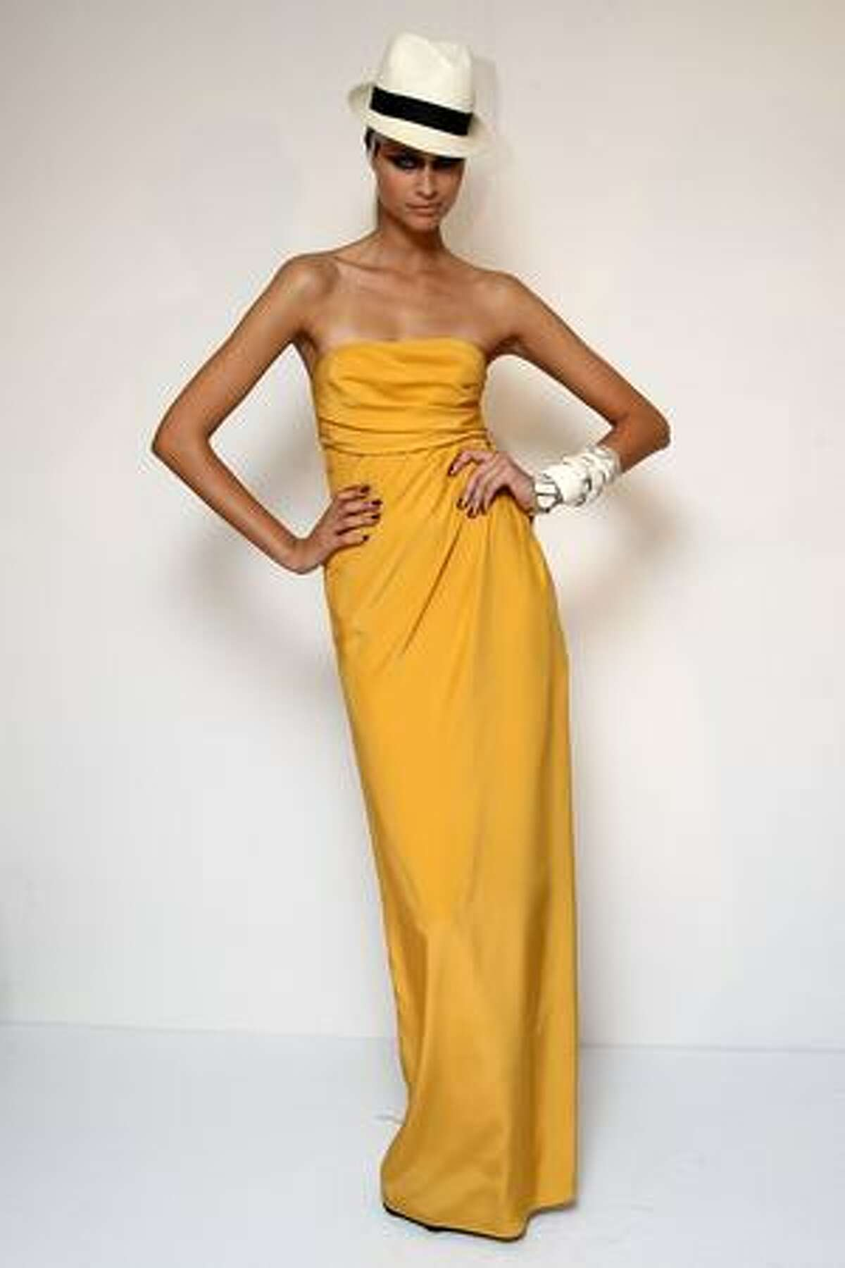 A model displays a creation by Monique Lhuillier.