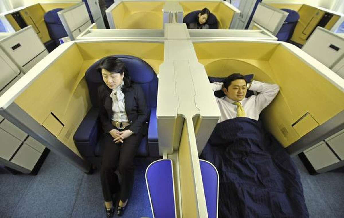 First-class seats in the new Boeing 777-300ER of Japan's All Nippon Airways are opened for the press at an ANA hangar in Narita International Airport, suburban Tokyo on April 16, 2010. The new aircraft is scheduled to commence flights from April 19 on the Narita-New York route.