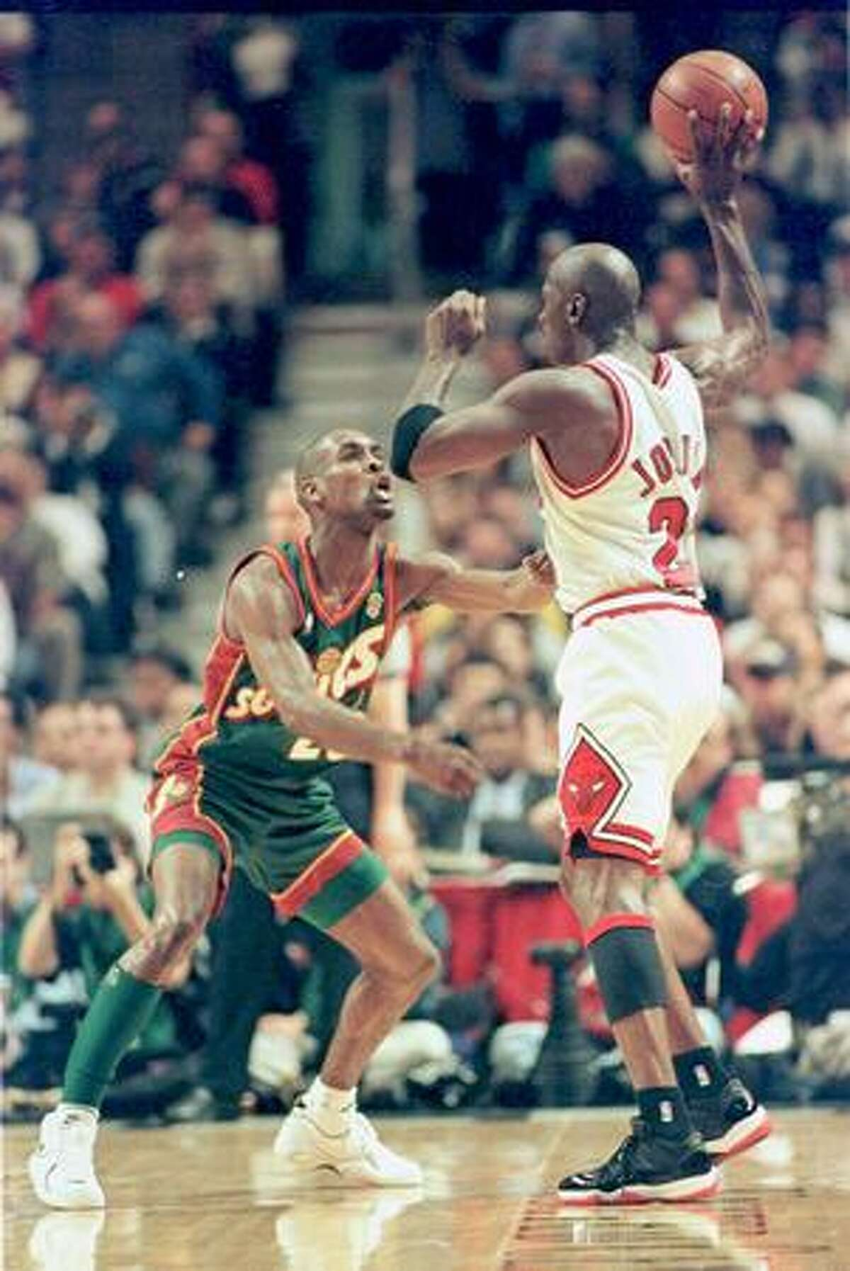 Gary Payton pressures Michael Jordan during Game 1 of the NBA Finals in Chicago, June 5, 1996. (Gilbert W. Arias/seattlepi.com file)