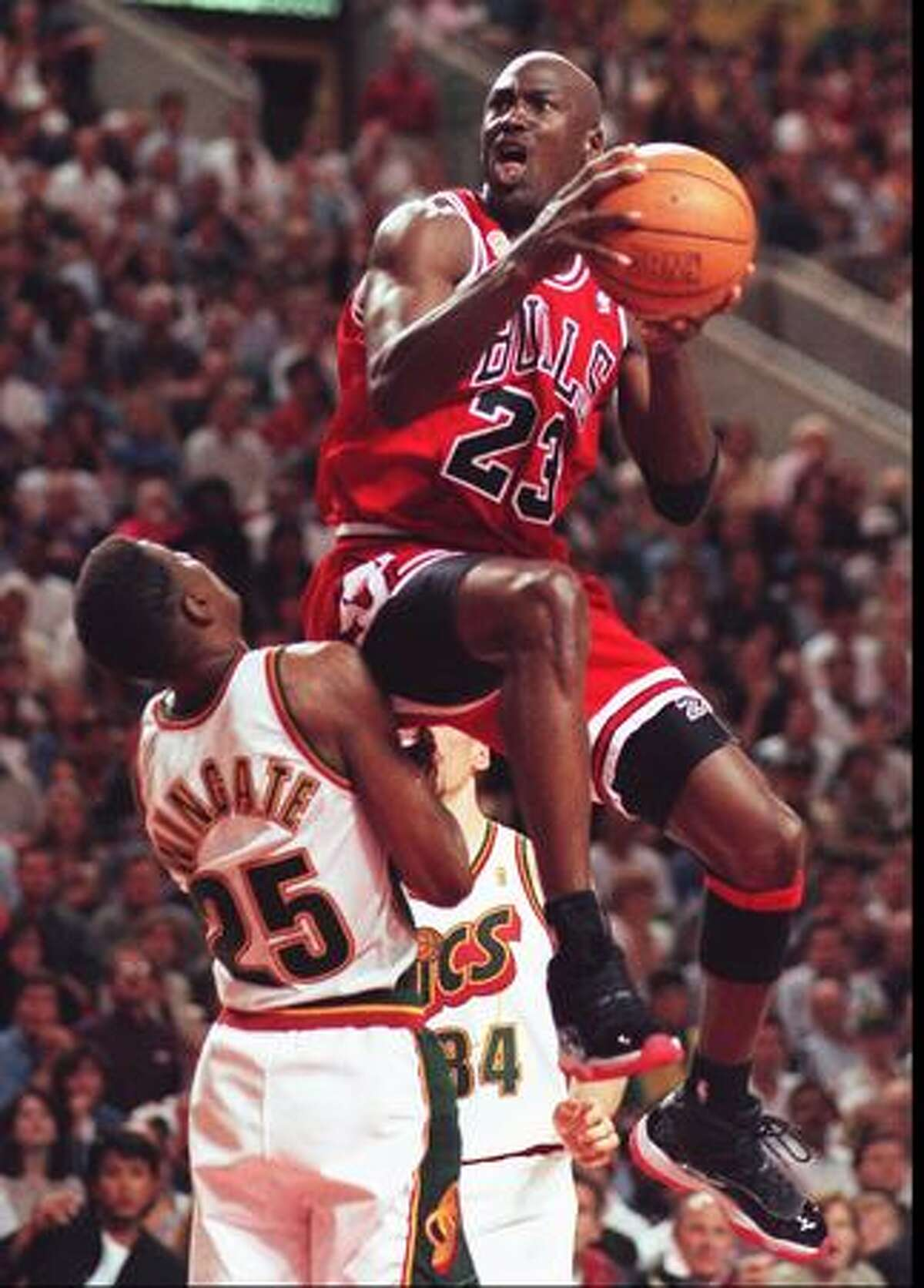 Michael Jordan goes over Sonics David Wingate, June 14, 1996. (Mike Urban/seattlepi.com file)