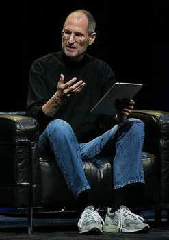 Apple CEO Steve Jobs announces the new iPad as he speaks during an Apple special event Jan. 27 at the Yerba Buena Center for the Arts in San Francisco. Apple introduced its latest creation, the iPad, a mobile tablet browsing device that is a cross between the iPhone and a MacBook laptop. Photo: Getty Images