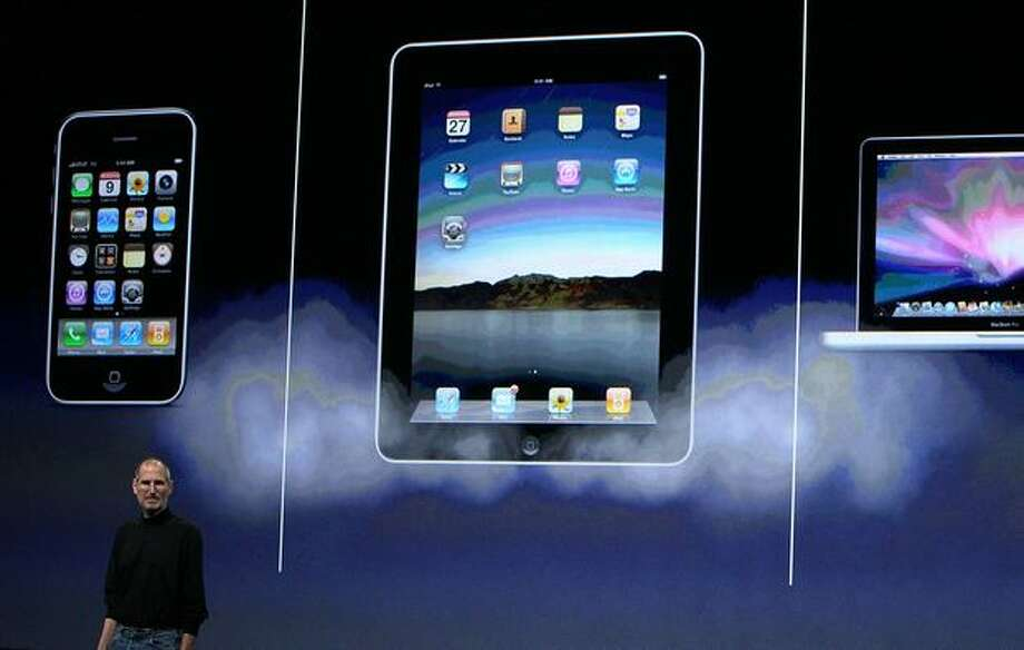 Apple Inc. CEO Steve Jobs announces the new iPad as he speaks during an Apple special event Jan. 27 at the Yerba Buena Center for the Arts in San Francisco. Photo: Getty Images