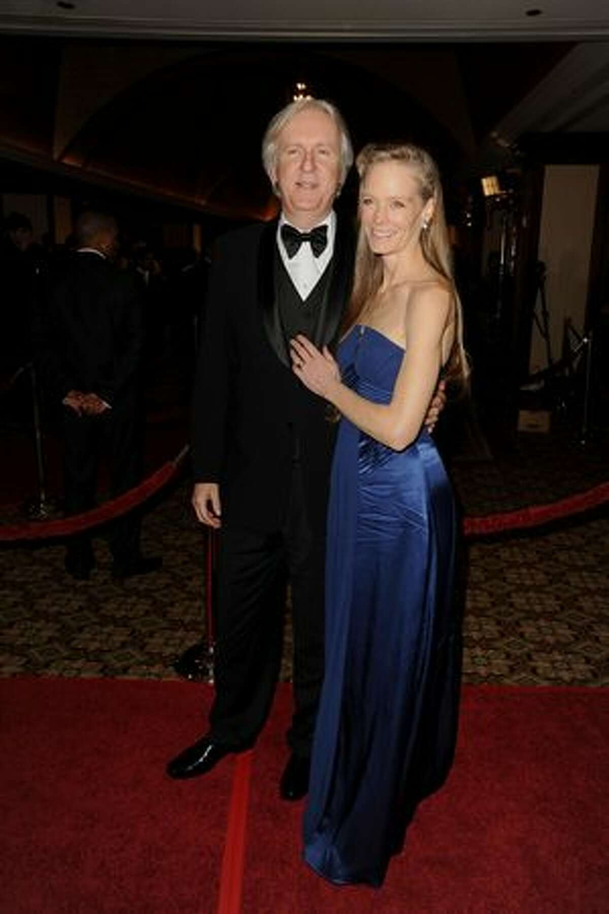 Director James Cameron (L) and wife Suzy Amis arrive.