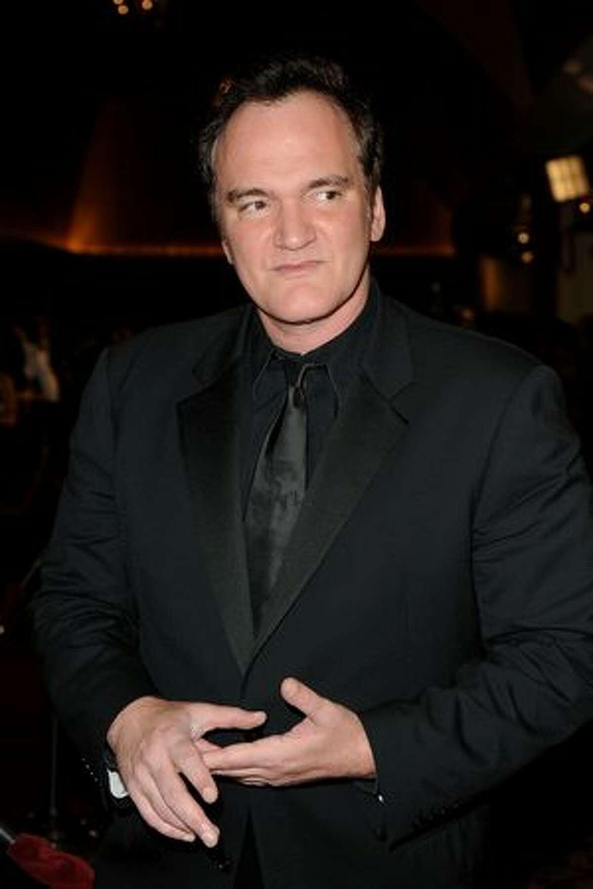 Director Quentin Tarantino arrives.