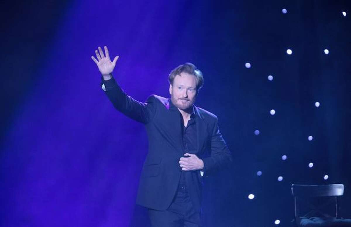 Comedian Conan O'Brien performs onstage at Seattle's McCaw Hall on Sunday, April 18, 2010. O'Brien performed as part of a tour before he starts a new show on cable TV network TBS. The comedian was greeted by some audience members who wore birthday hats and tossed balloons to celebrate the comedian's birthday.