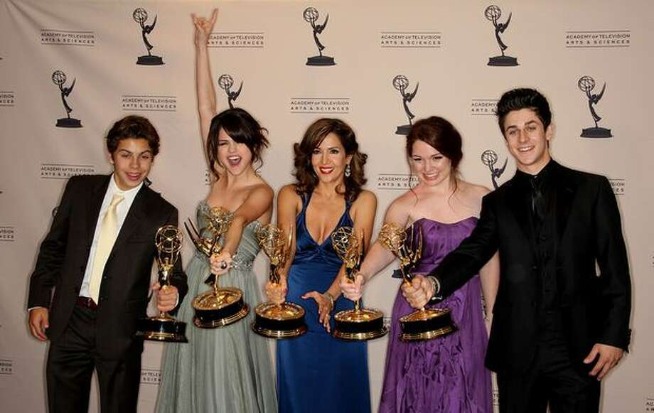 "April 18, 1983:The Disney Channel, which has launched the careers of many of today's stars, begins broadcasting. (thewaltdisneycompany.com) Above: Actress Selena Gomez (second left) and the cast of ""Wizards of Waverly Place"" celebrate their Emmys. Photo: Getty Images"