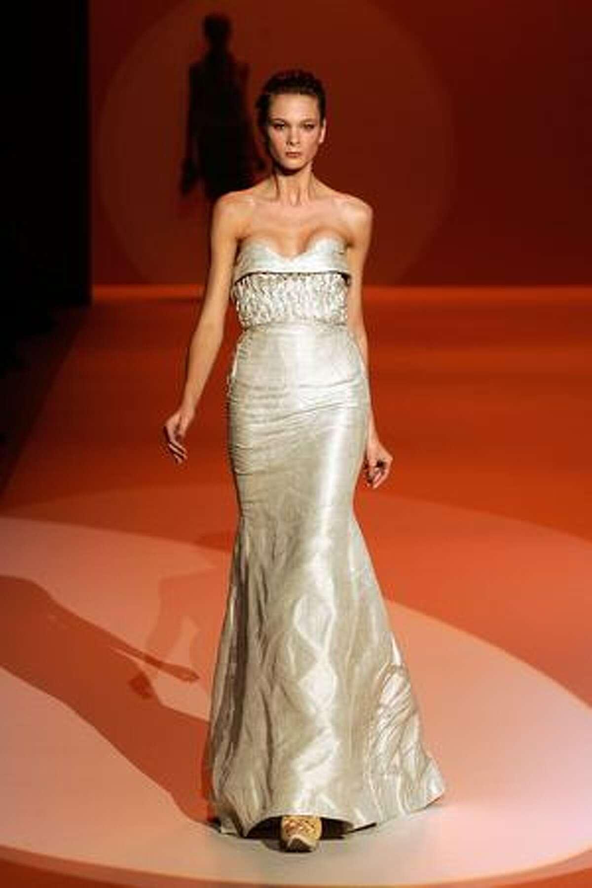 A model walks the runway at Carolina Herrera Spring 2010 fashion show at Bryant Park in New York, New York.