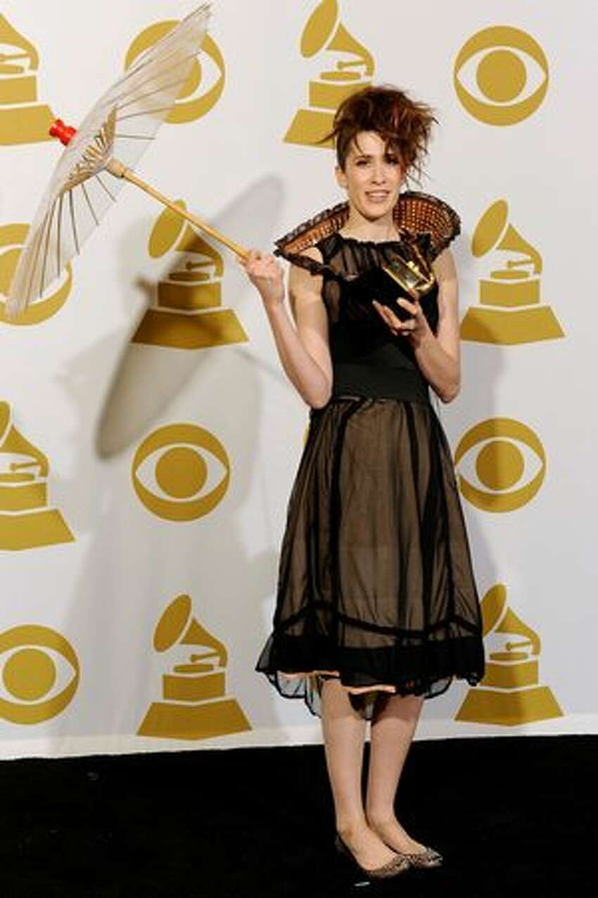 Singer Imogen Heap poses with Best Engineered Album award for 'Ellipse' in the press room.