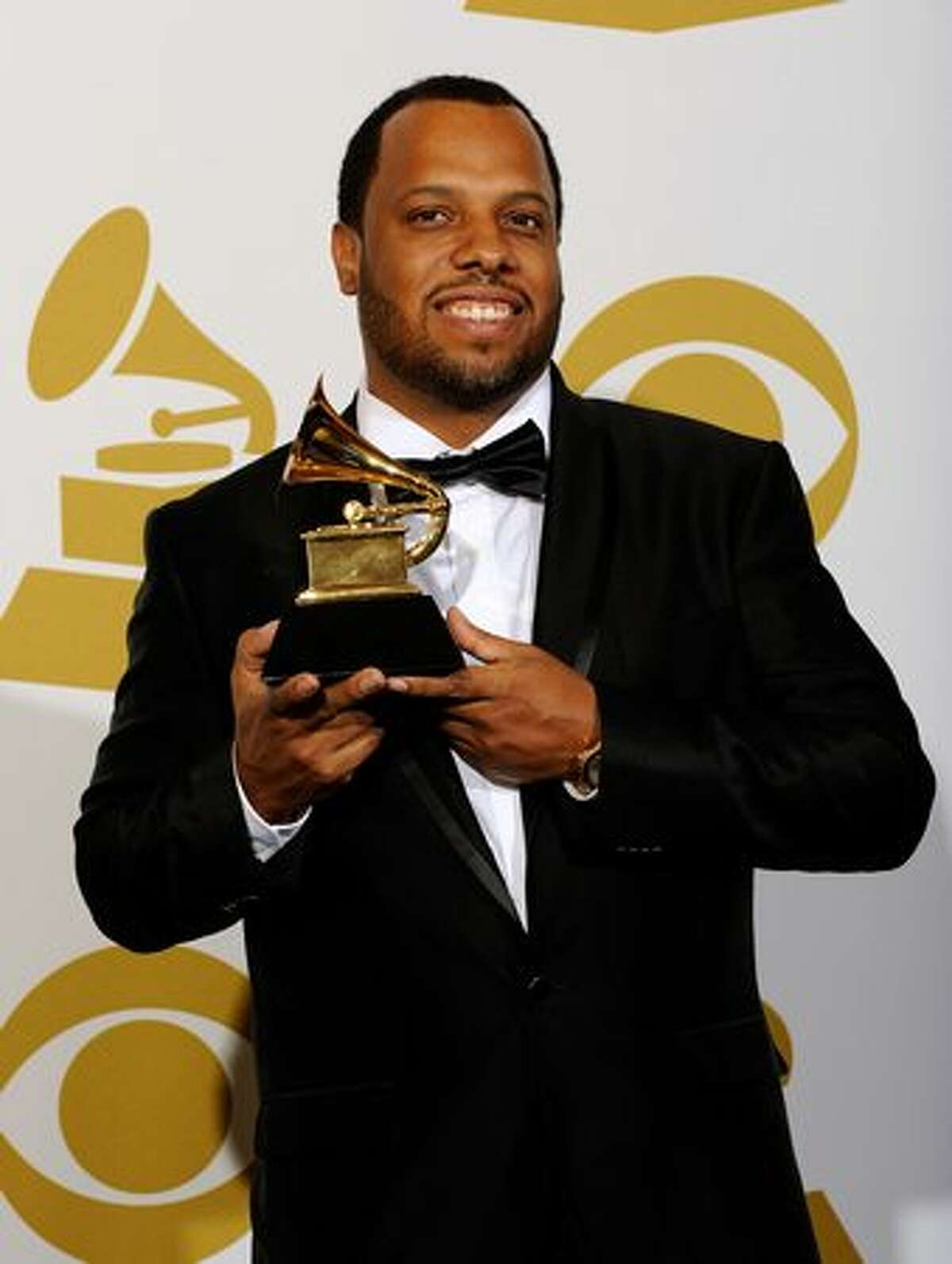 Songwriter Ernest Wilson poses with Best Rap Song award for 'Run This Town' in the press room.