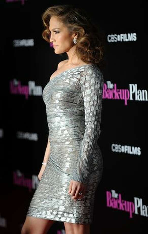 """Actress Jennifer Lopez arrives with her husband, singer Marc Anthony at the premiere of """"The Back-up Plan"""" in Westwood, Calif., on April 21, 2010. Photo: Getty Images"""