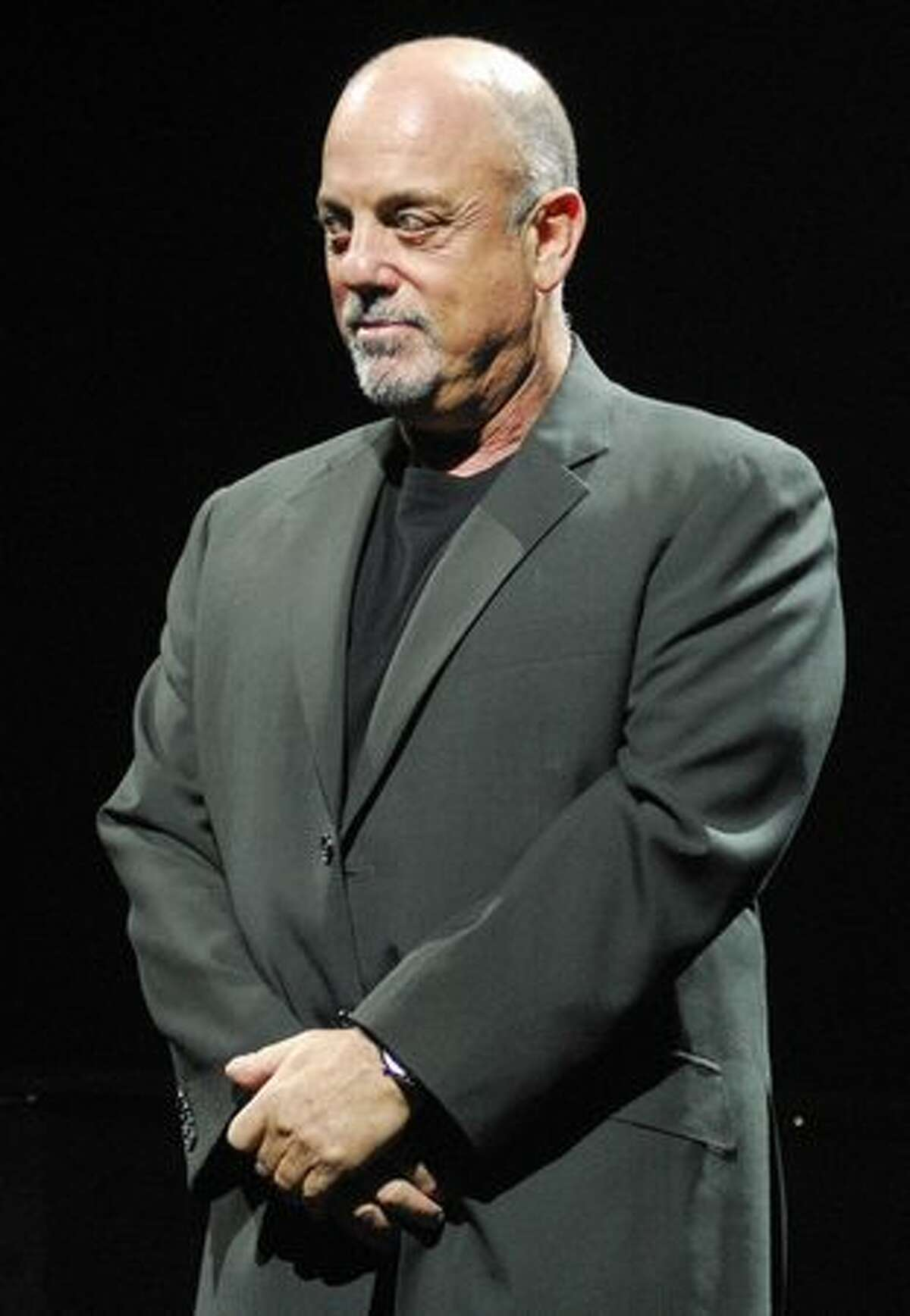 Billy Joel waits for Elton John to take the stage.