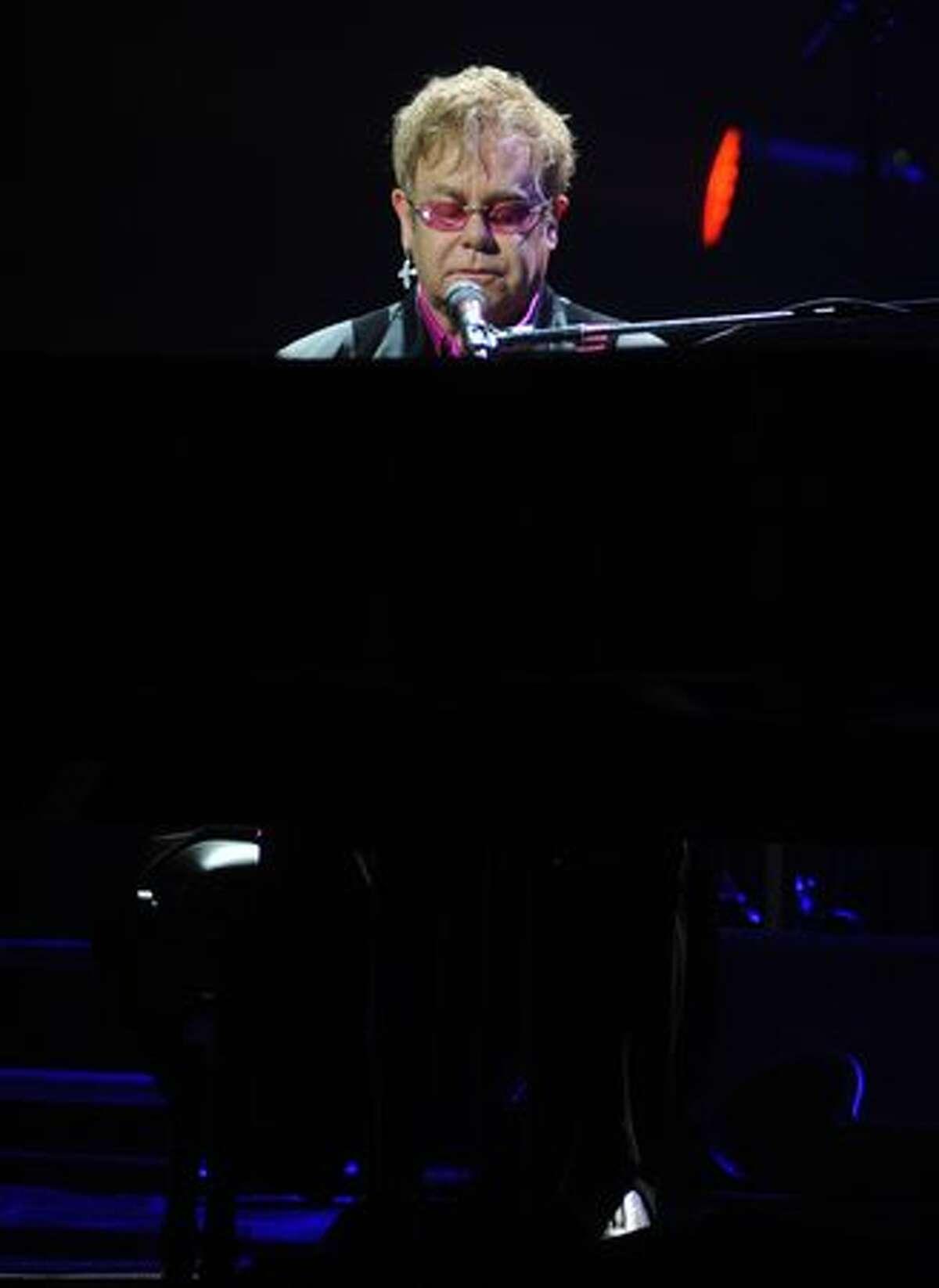 Elton John performs.