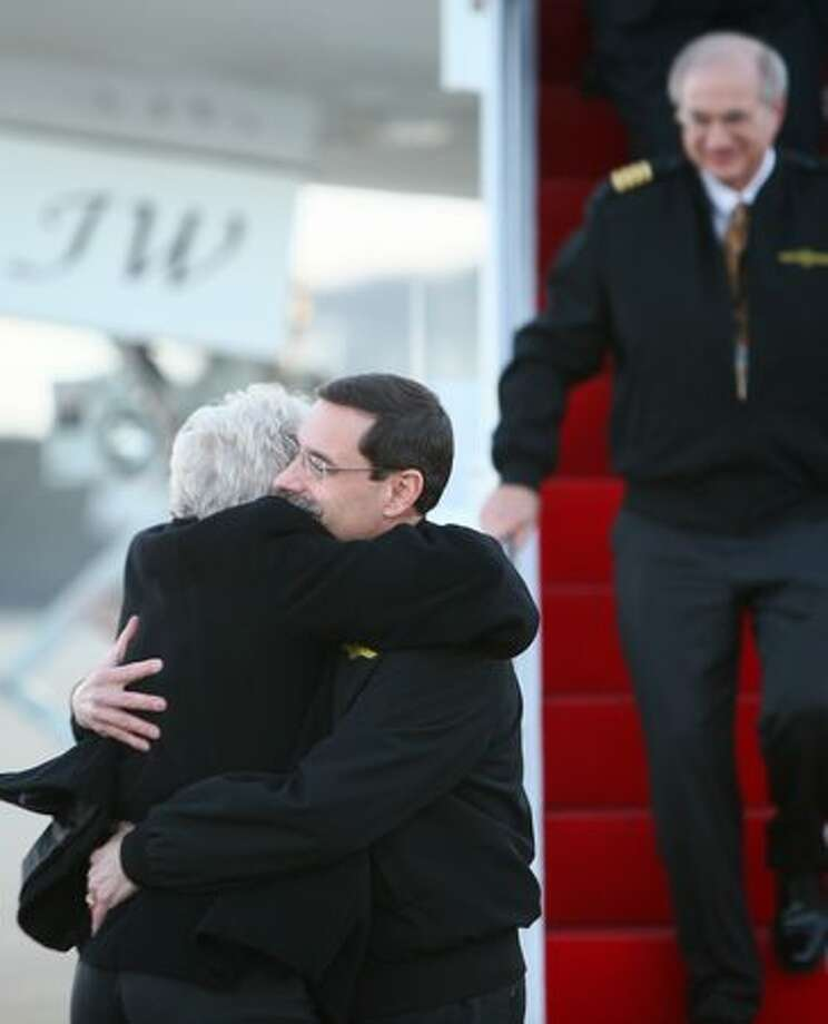 Capt. Mark Feuerstein is hugged by his wife Cindy after departing Boeing's new 747-8 after a successful test flight. At right is first officer Capt. Tom Imrich. Photo: Joshua Trujillo, Seattlepi.com