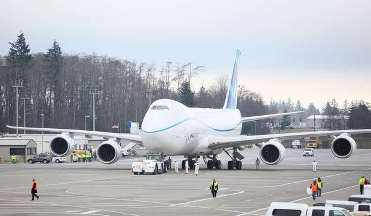 Boeing's new 747-8 is pulled by a tug from its parking stall before its first flight at Paine Field in Everett.