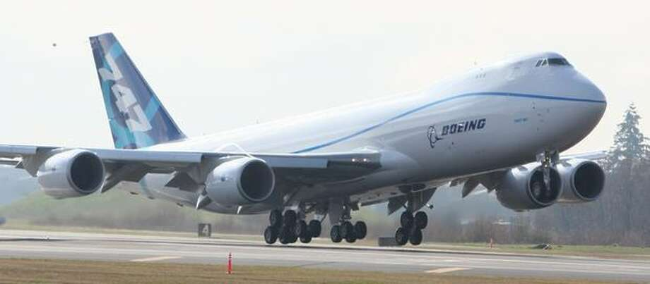 Boeing's new 747-8 takes off from Paine Field in Everett. The plane's first flight was delayed more than two hours by weather conditions. Photo: Joshua Trujillo, Seattlepi.com