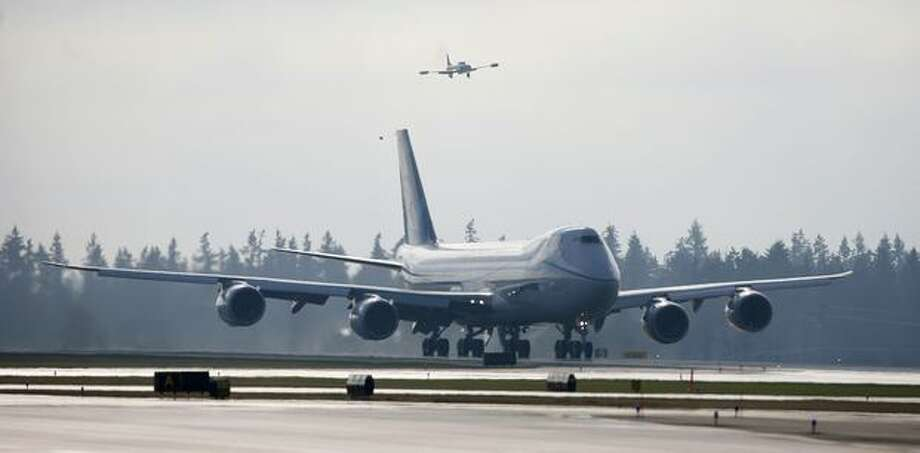 Boeing's new 747-8 starts down the runway for its maiden flight from Paine Field in Everett. Photo: Joshua Trujillo, Seattlepi.com