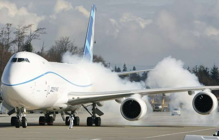 The engines on Boeing's new 747-8 are fired up before the new airplane's maiden flight. Photo: Joshua Trujillo, Seattlepi.com