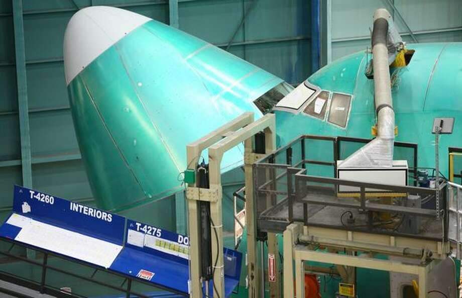 The nose of a 747-8 is open on the assembly line at the Boeing factory in Everett. Photo: Joshua Trujillo, Seattlepi.com