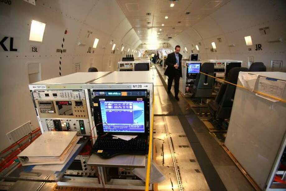 The interior of one of Boeing's new 747-8 test airplanes shows testing equipment. Photo: Joshua Trujillo, Seattlepi.com