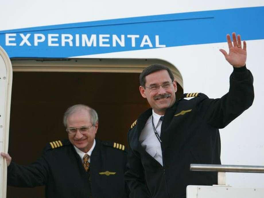 Boeing test pilot Capt. Tom Imrich, left, and Capt. Mark Feuerstein exit Boeing's new 747-8. Photo: Joshua Trujillo, Seattlepi.com