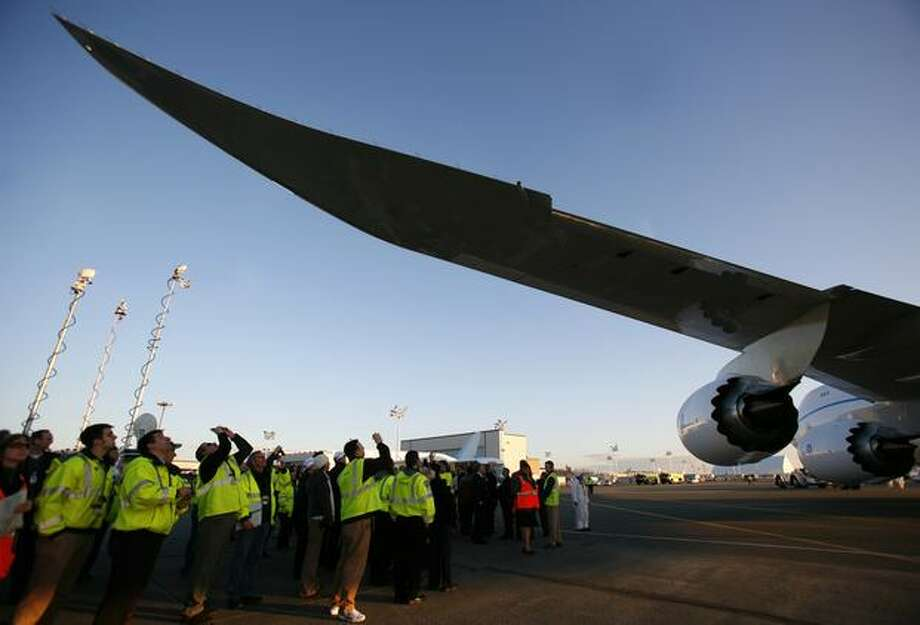 The wing of Boeing's new 747-8 passes over spectators as the plane is parked. Photo: Joshua Trujillo, Seattlepi.com