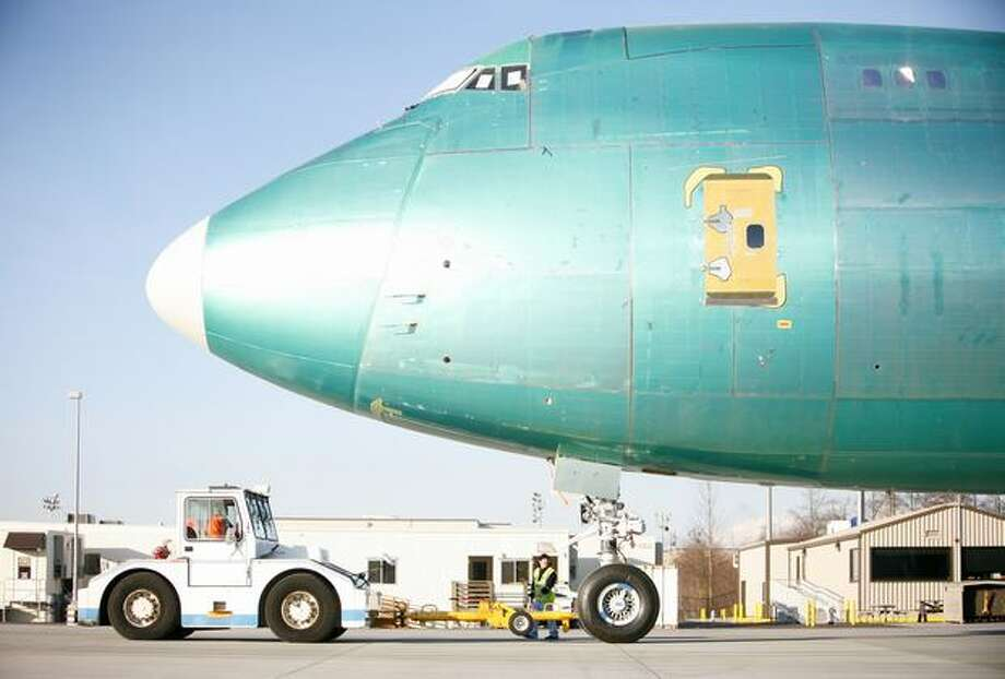 A Boeing 747-8 is towed into a parking stall at Paine Field. Photo: Joshua Trujillo, Seattlepi.com