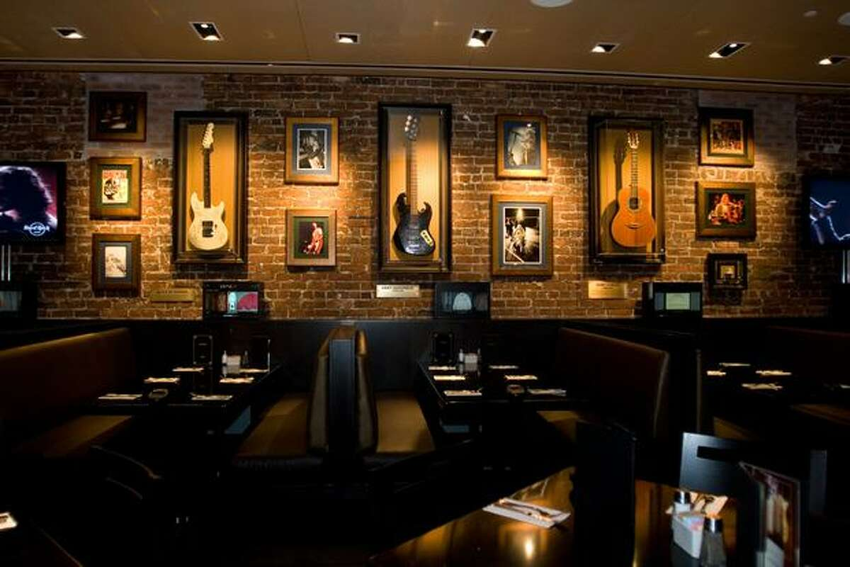 FILE PHOTO: Booths with memorabilia hanging above them at the Hard Rock Cafe.