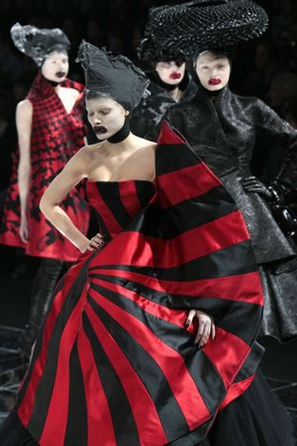 Models present creations by Britishn designer Alexander McQueen during the autumn/winter 2009 ready-to-wear collection show in Paris, on March 10, 2009. Photo: Getty Images