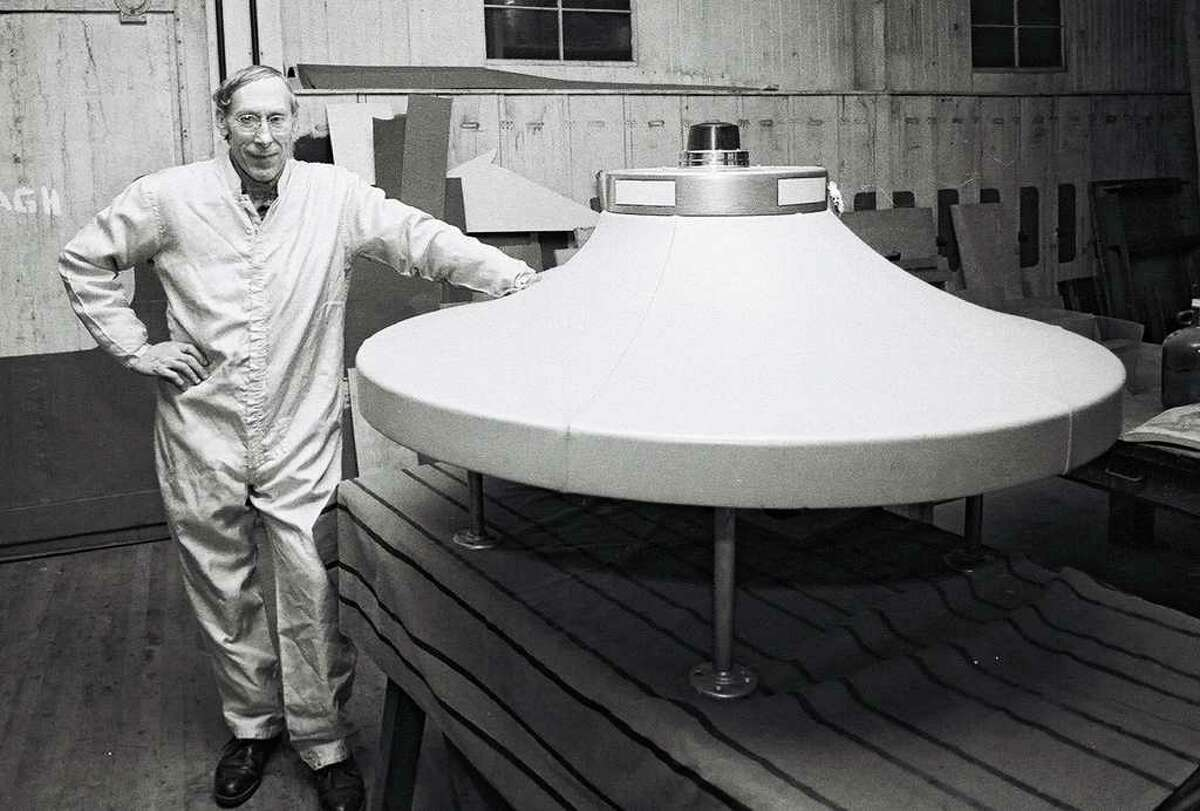 Dante Vaghi, stands by a spaceship that he created in this 1982 News-Times file photo.