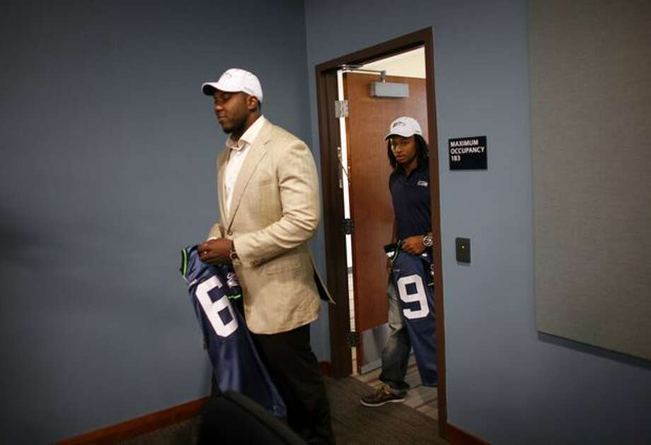 New Seattle Seahawks Russell Okung from Oklahoma State, left, and Earl Thomas from University of Texas enter the room to be introduced on Saturday April 24, 2010 at the Virginia Mason Athletic Center in Renton. Okung was the Hawks first draft pick and Thomas was the teams second.(Joshua Trujillo, Seattlepi.com).... Photo: Joshua Trujillo, Seattlepi.com
