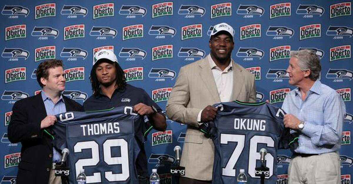 Earl Thomas (29) from University of Texas and Russell Okung (76) from Oklahoma State are introduced by Seahawks General Manager John Schneider, left, and Seahawks head coach Pete Carroll on Saturday April 24, 2010 at the Virginia Mason Athletic Center in Renton. Okung was the Hawks first draft pick and Thomas was the teams second.(Joshua Trujillo, Seattlepi.com)....